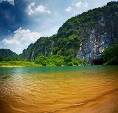 image of cave  - Clear river at sunny day near the entrance to cave of Phong Nha - JPG