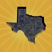stock photo of texas map  - Texas map on dollars sunburst illustration - JPG