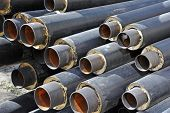 image of insulator  - Steel pipe with heat insulation on construction site - JPG