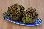 picture of boil  - Boiled artichokes with thyme on the wooden background - JPG