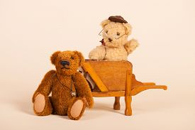 picture of hand-barrow  - Stuffed bears in vintage wheel barrow isolated over white background - JPG