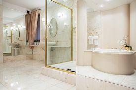 stock photo of enormous  - Two big mirrors in enormous luxury bathroom - JPG