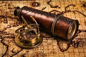 Постер, плакат: Travel geography navigation concept background old vintage retro compass with sundial and spyglass