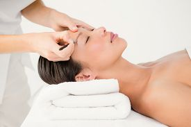 stock photo of eyebrows  - Woman using tweezers on patient eyebrow at the health spa - JPG