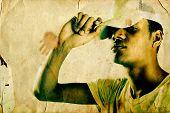 image of gangsta  - Grunge Portrait of Male Rapper in studio  - JPG