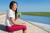 Healthy morning breakfast runner athlete drinking green smoothie juice drink cup before race for an  poster