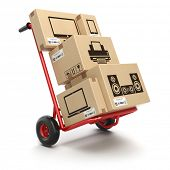Sale and delivery of computer technics concept. Hand truck and cardboard boxes with PC, laptop, comp poster