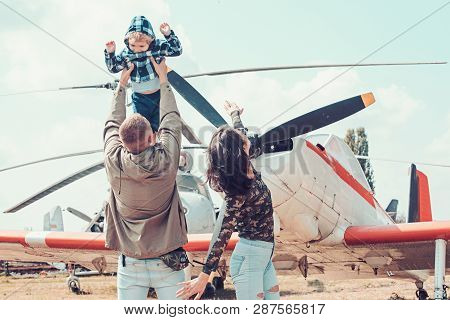 poster of Flying Like A Bird. Woman And Man With Boy Child At Helicopter. Happy Family Vacation. Family Couple