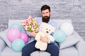 Best Way To Say You Care. Spring Gift. Bearded Man Hipster With Spring Flowers. Flower For March 8.  poster