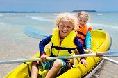 Kids Kayaking In Ocean. Children In Kayak In Tropical Sea poster