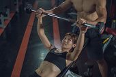 Personal Trainer Helping Woman Bench Press In Gym, Training With Barbell, Personal Trainer Helping W poster