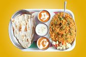 Indian Biryani, Butter Naan With Spicy Curry poster