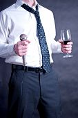 picture of emcee  - Image of a man holding a microphone and a drink - JPG