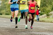 African And European Runners Athletes Running Marathon In Group poster