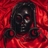 Bondage, Kinky Adult Sex Games, Kink And Bdsm Lifestyle Concept With A Mask, Pair Of Leather Handcuf poster