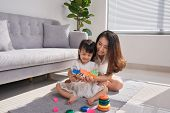 Happy Loving Family. Mother And Daughter Are Doing Play A Toy And Having Fun. Mother And Daughter Do poster