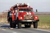 Постер, плакат: Красный огонь грузовик