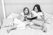 Children Read Book In Bed. Family Tradition. Girls Best Friends Read Fairy Tale Before Sleep. Best B poster