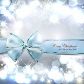 pic of shimmer  - Elegant Christmas background with blue bow and place for text - JPG