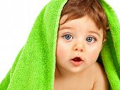 stock photo of baby toddler  - Image of cute baby boy covered with green towel isolated on white background - JPG