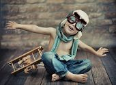 foto of emotions faces  - A small boy playing - JPG