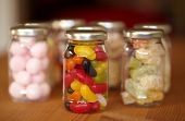 stock photo of jelly babies sugar  - Colorful jelly beans in jar - JPG
