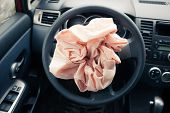 stock photo of rudder  - Airbag explodes on steering wheel - JPG