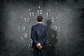 pic of stopwatch  - Businessman standing and making his choice between times - JPG