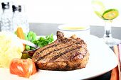 picture of pork chop  - image of a gourmet pork chop meal - JPG