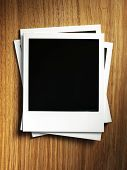 picture of polaroid  - Polaroid photo frame on wood background - JPG