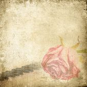 stock photo of outdated  - Old music background with rose - JPG