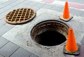 image of manhole  - Manhole cover open on the footbath near street - JPG