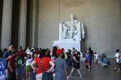 WASHINGTON, D.C. - JULY 29: Tourists walk near the statue of Abraham Lincoln at the Lincoln Memorial