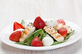 picture of quail  - Spinach grilled chicken strawberry and quail eggs salad with balsamic vinegar on white plate - JPG