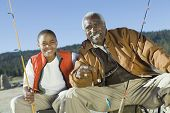 pic of fishing rod  - Portrait of happy grandfather and grandson fishing together - JPG
