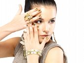 pic of minx  - Pretty woman with golden nails and beautiful gold jewelry isolated on white background - JPG
