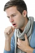 stock photo of respiratory disease  - portrait of an young man coughing with fist - JPG