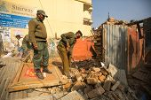 KATHMANDU, NEPAL - DEC 24: Unknown nepalese police during a operation on demolition of residential s
