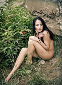 picture of nu  - Beautiful young nude woman against old fort and the sea - JPG