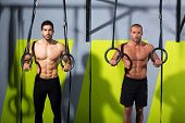 foto of dipping  - Crossfit dip ring two men workout at gym dipping exercise - JPG