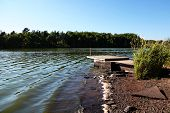 stock photo of dock a pond  - Pond with Boat Dock - JPG