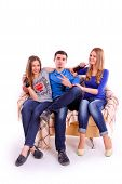 image of coca-cola  - Young people sitting on a sofa and drinking Coca Cola isolated - JPG
