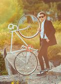 picture of bicycle gear  - Young stylish guy with fixed gear bicycle outdoors - JPG