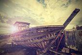foto of junk-yard  - Vintage Old Boat on Junk Yard - JPG