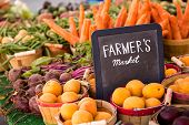 stock photo of laxatives  - Fresh organic apricots on sale at the local farmers market - JPG