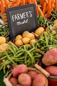 image of root-crops  - Fresh organic produce on sale at the local farmers market.