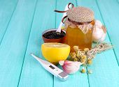 image of home remedy  - Folk remedies for colds on wooden table - JPG