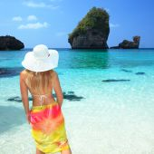 stock photo of tropical island  - Beautiful woman on the beach - JPG