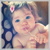 foto of cook eating  - Sweet baby eating noodles  - JPG