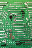 stock photo of pegboard  - Hand tool set on green pegboard in garage - JPG
